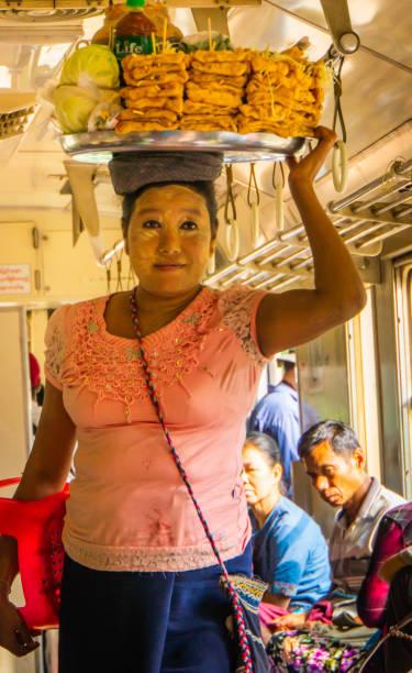 Burmese women selling food to passengers stock photo