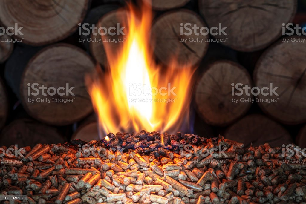 burn wood pellet and trunks stock photo