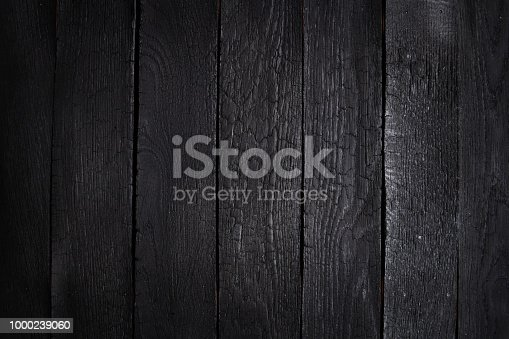 istock Burn wooden background 1000239060