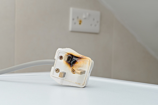 Burned 250V uk style socket and converter. Improper use of AC Power Plugs and Sockets cause of short circuit and fires at home