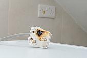 istock Burned ac Power Plugs and Sockets 1065223432