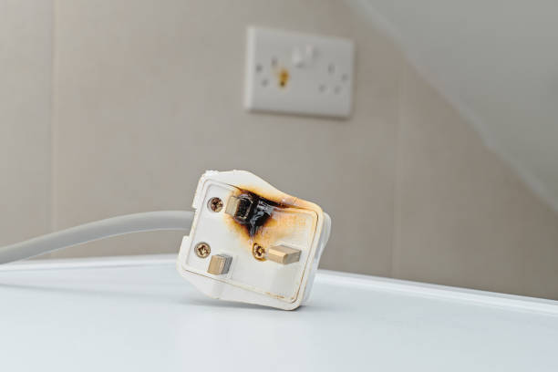 Burned ac Power Plugs and Sockets stock photo