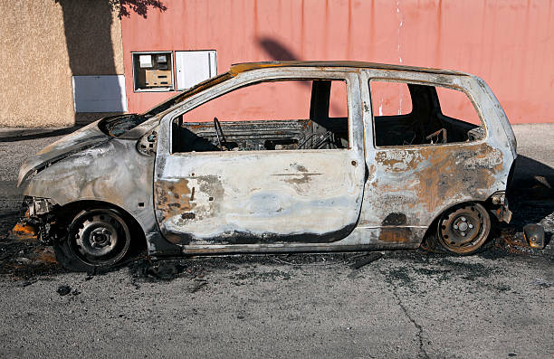 burned car - depredation stock pictures, royalty-free photos & images