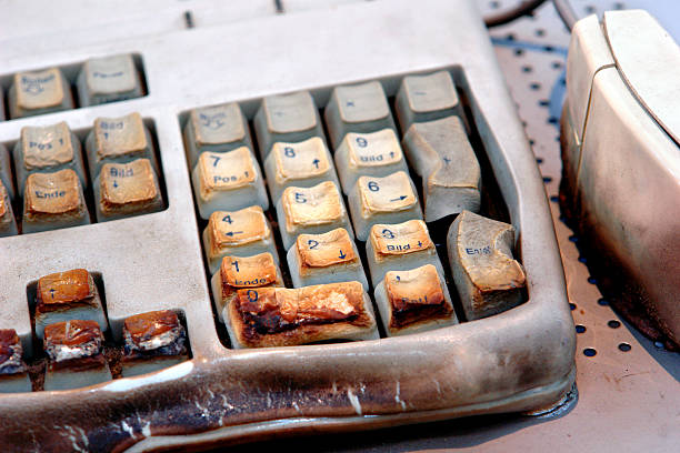 burned computer keyboard - defection stock photos and pictures
