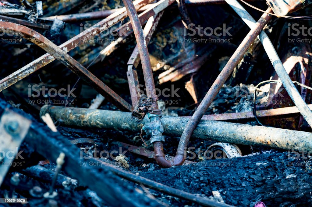 Burned damaged ruins of destroyed sprinkler fire protection system in supermarket. Arson investigation insurance stock photo