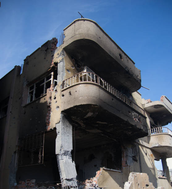 Burned Demaged Home after attack stock photo