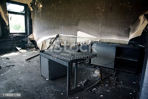 Burned interiors and furniture in industrial or office building. Fire consequences concept.