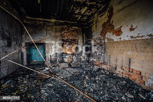 istock Burned interiors of industrial hall after fire in the factory 865947212