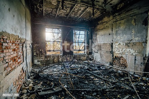 istock Burned interiors of industrial hall after fire in the factory 865947288