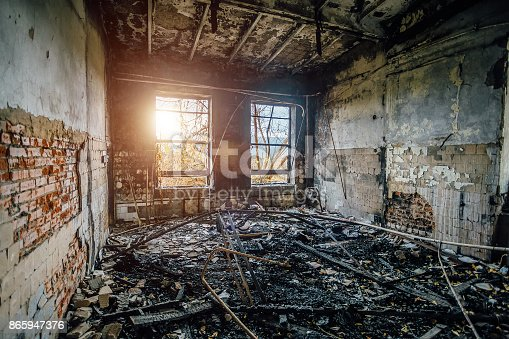 istock Burned interiors of industrial hall after fire in the factory 865947376