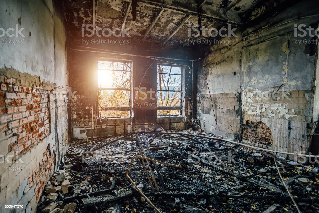 Burned interiors of industrial hall after fire in the factory stock photo