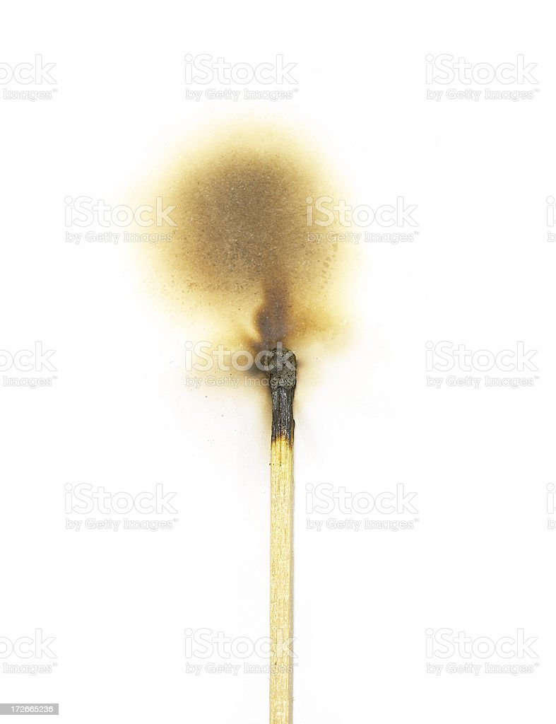 Burned match on paper royalty-free stock photo