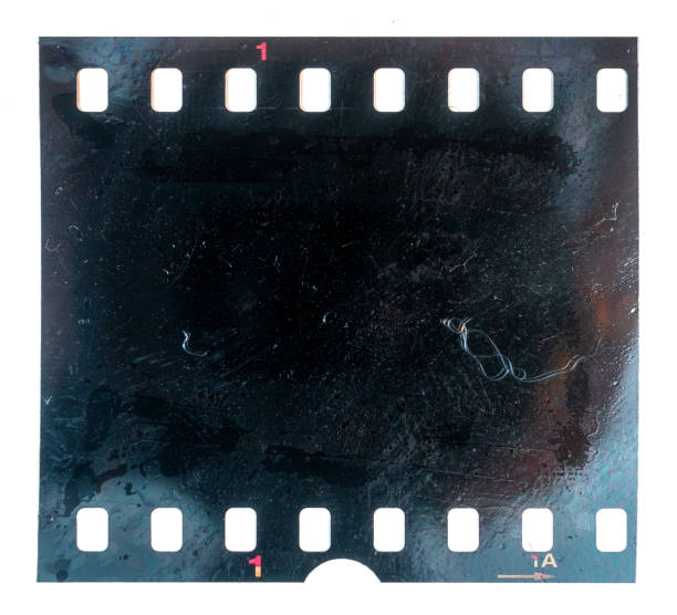 burned or burnt 35mm filmstrip or film material on white background, exposed and black film burned film material camera film stock pictures, royalty-free photos & images