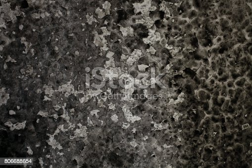 istock Burned wall texture. Burned wall background. Detail of a wall destroyed by fire. Abstract background and texture for designers. Close up view of burned wall. Grunge wall. 806688654
