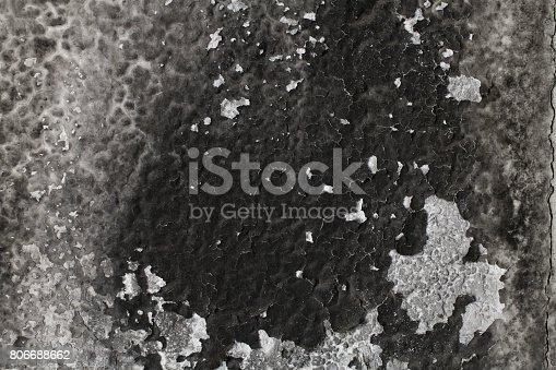 istock Burned wall texture. Burned wall background. Detail of a wall destroyed by fire. Abstract background and texture for designers. Close up view of burned wall. Grunge wall. 806688662