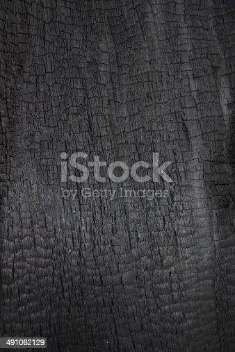 istock Burned wood as  background 491062129