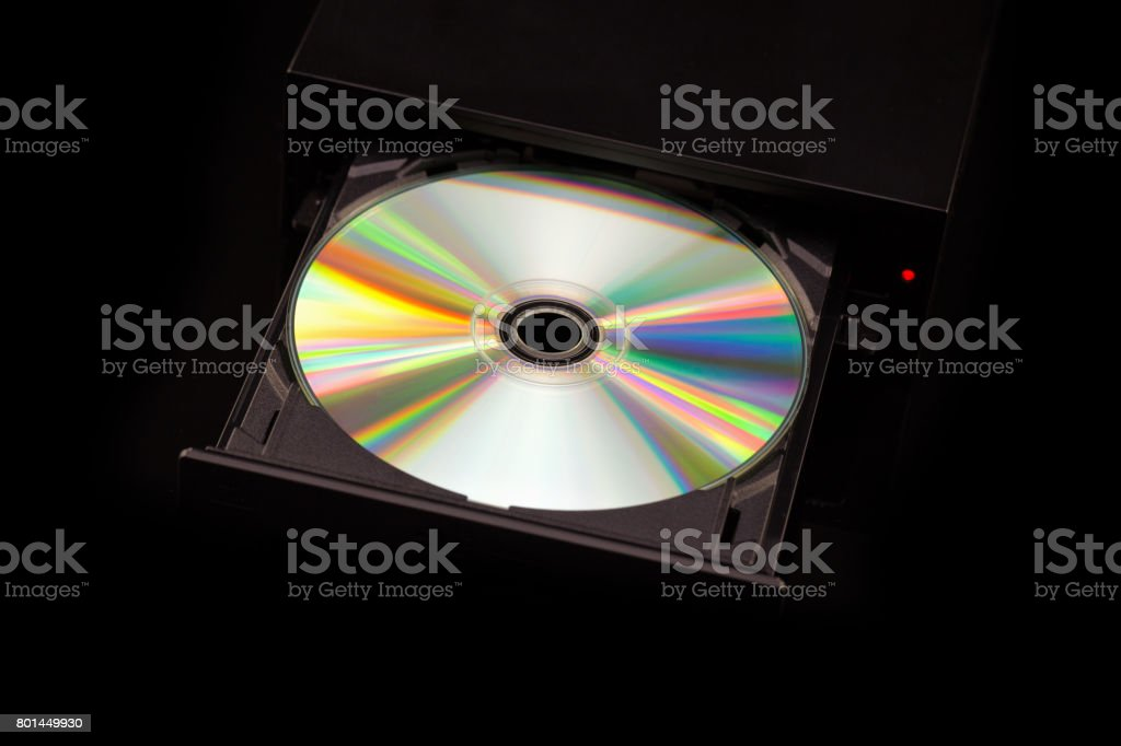DVD / CD burner on black background. Top view stock photo