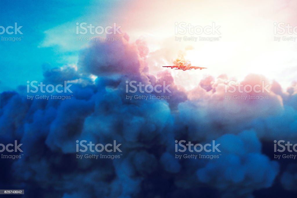 Burning airplane in the sky stock photo