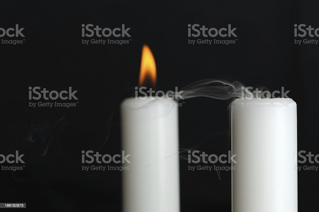 Burning and Blown Out Candle with Smoke stock photo