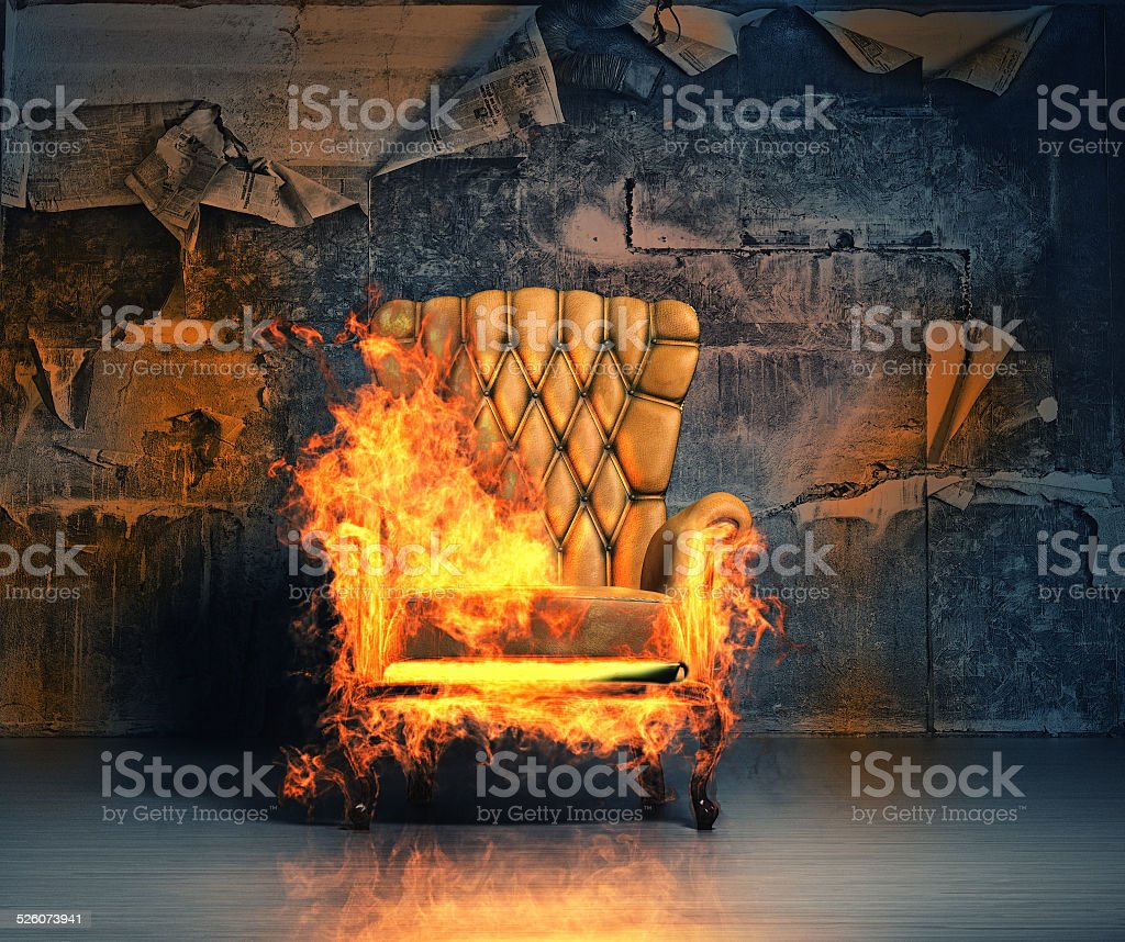burning armchair stock photo