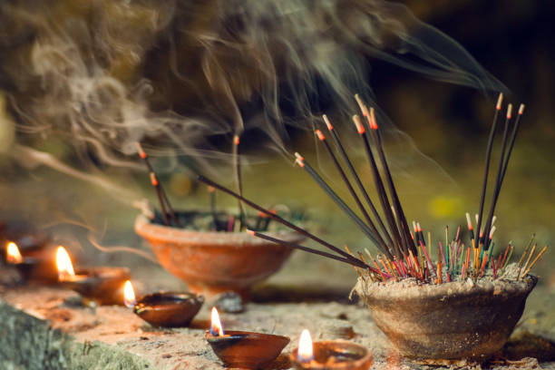 Burning aromatic incense sticks. Incense for praying Buddha or Hindu gods to show respect Burning aromatic incense sticks. Incense for praying Buddha or Hindu gods to show respect. incense stock pictures, royalty-free photos & images