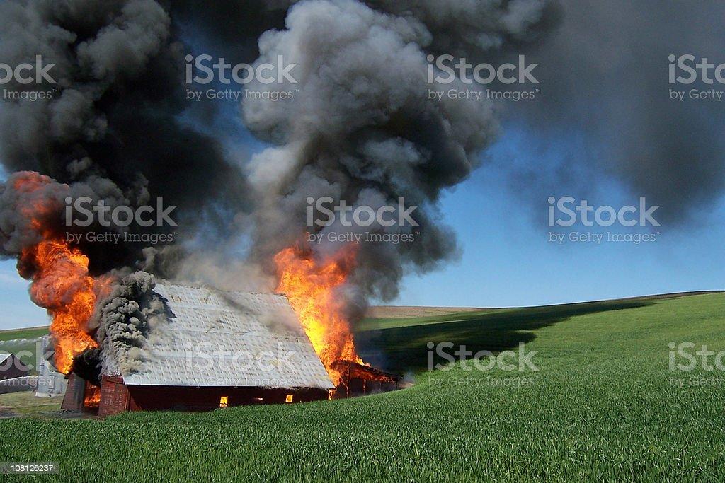 Burning Barn in the Palouse stock photo