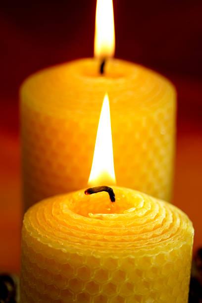 Burning bees wax candles stock photo