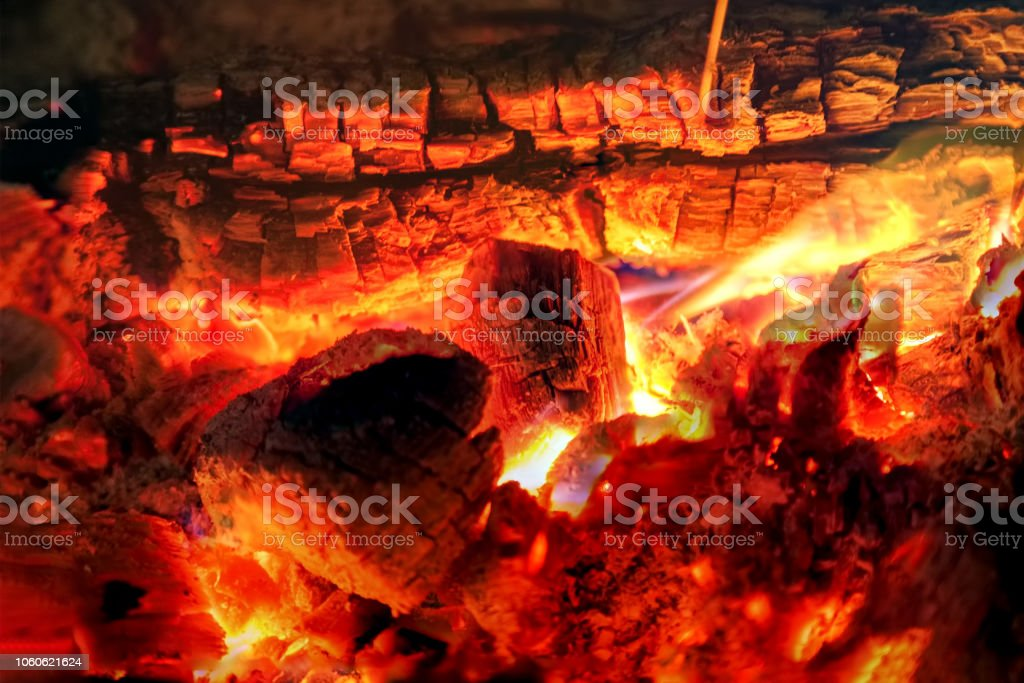 Burning billets in fireplace stock photo