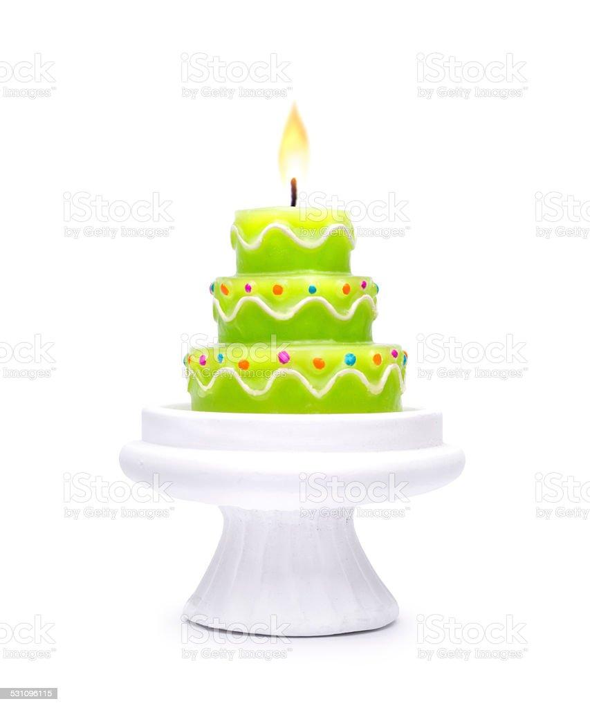 Burning birthday cake candle on white background stock photo