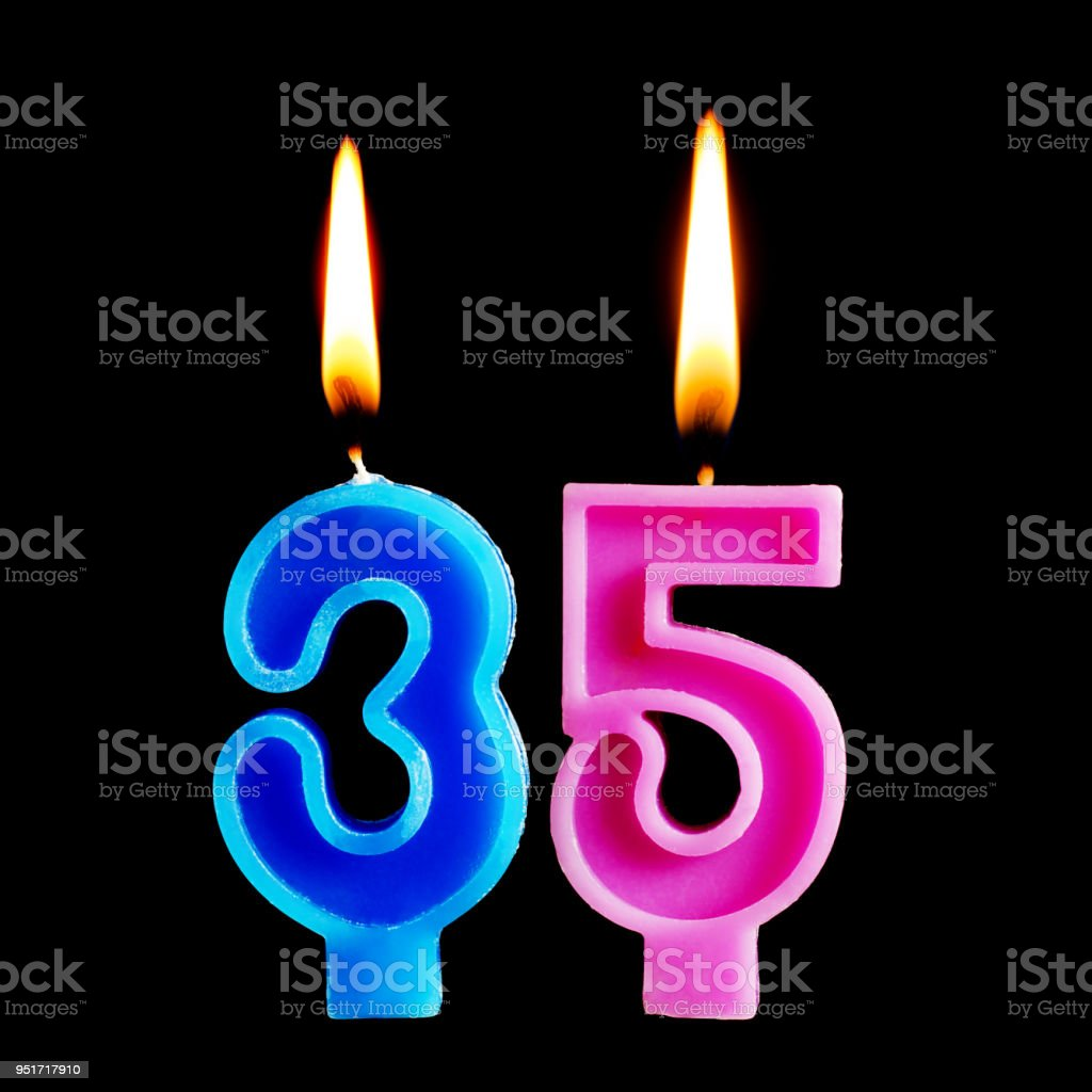 Burning birthday candles in the form of 35 thirty five figures for cake isolated on black background. The concept of celebrating a birthday, anniversary, important date, holiday stock photo