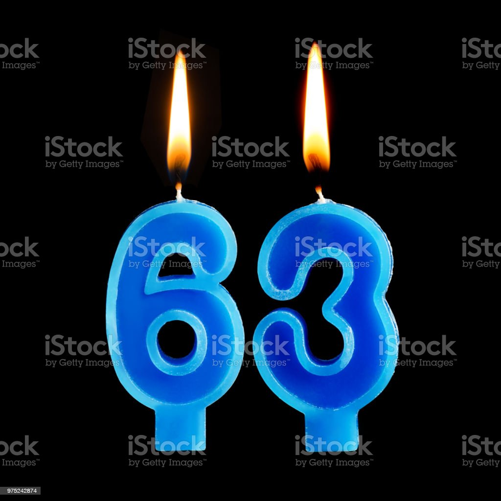 Burning birthday candles in the form of 63 sixty three for cake isolated on black background. stock photo