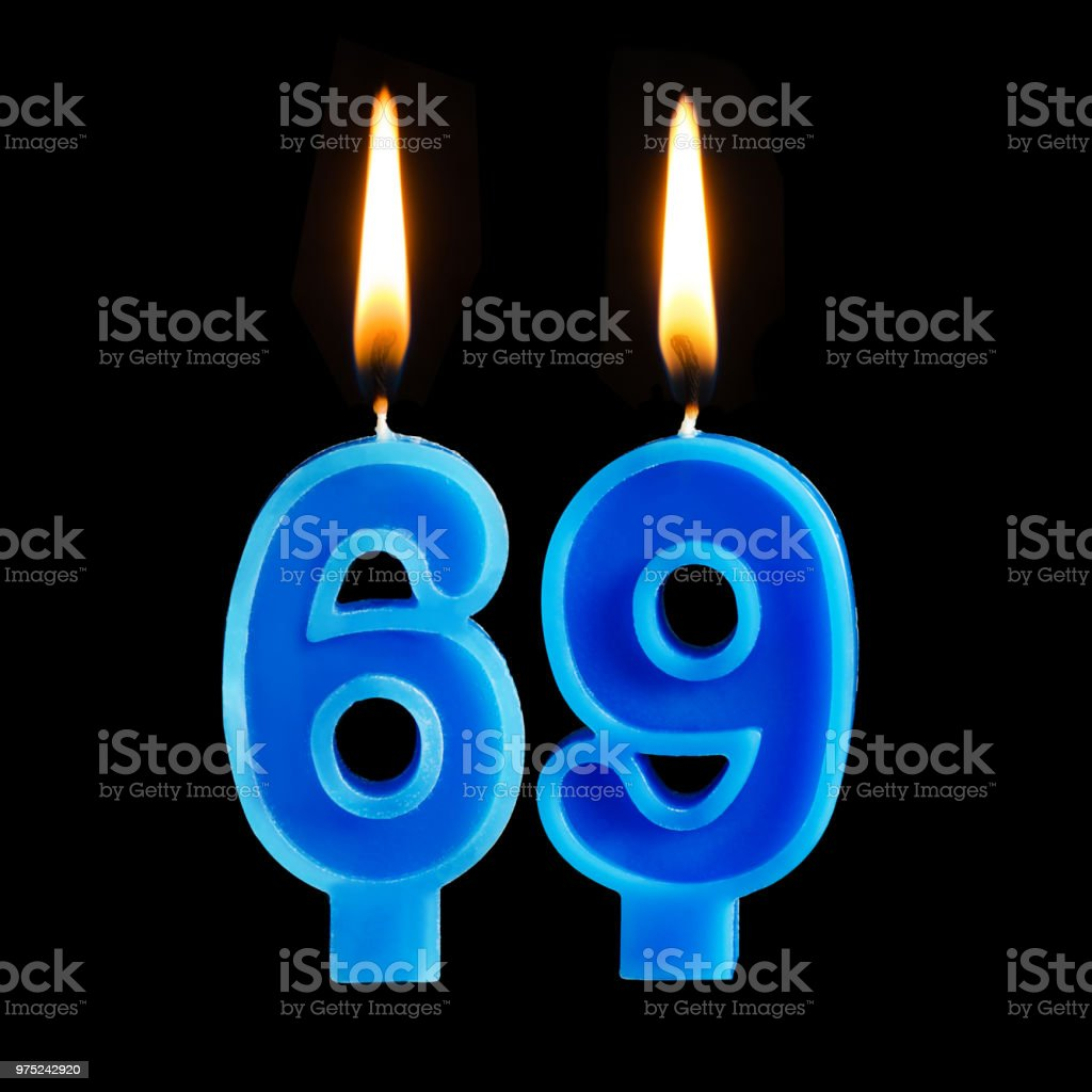 Burning Birthday Candles In The Form Of 69 Sixty Nine For Cake Isolated On Black Background