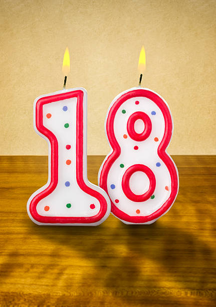 burning birthday candles number 18 - number 18 stock photos and pictures