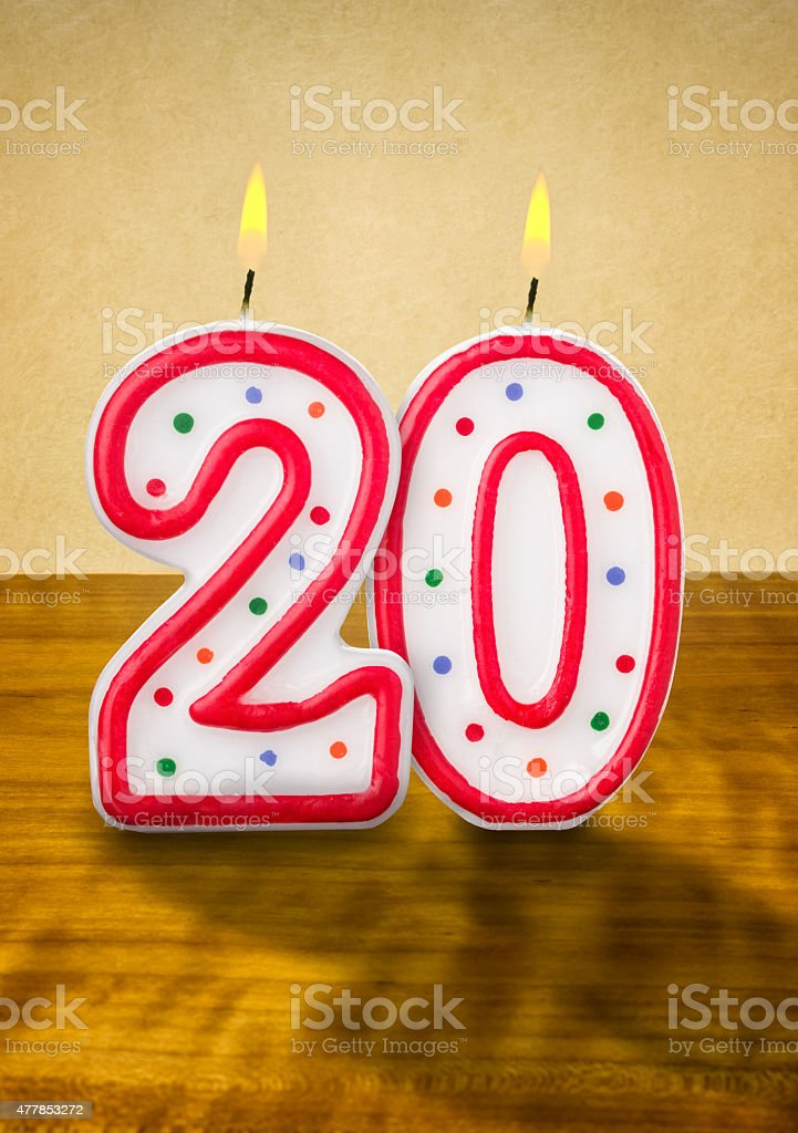 Burning birthday candles number 20 stock photo