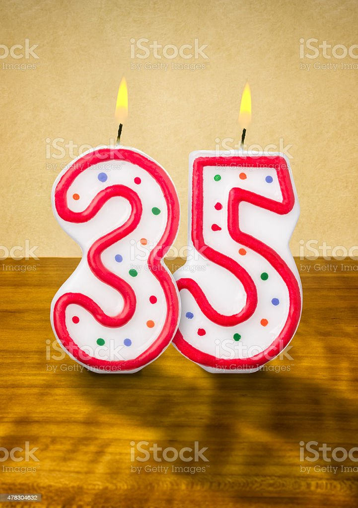 Burning birthday candles number 35 stock photo