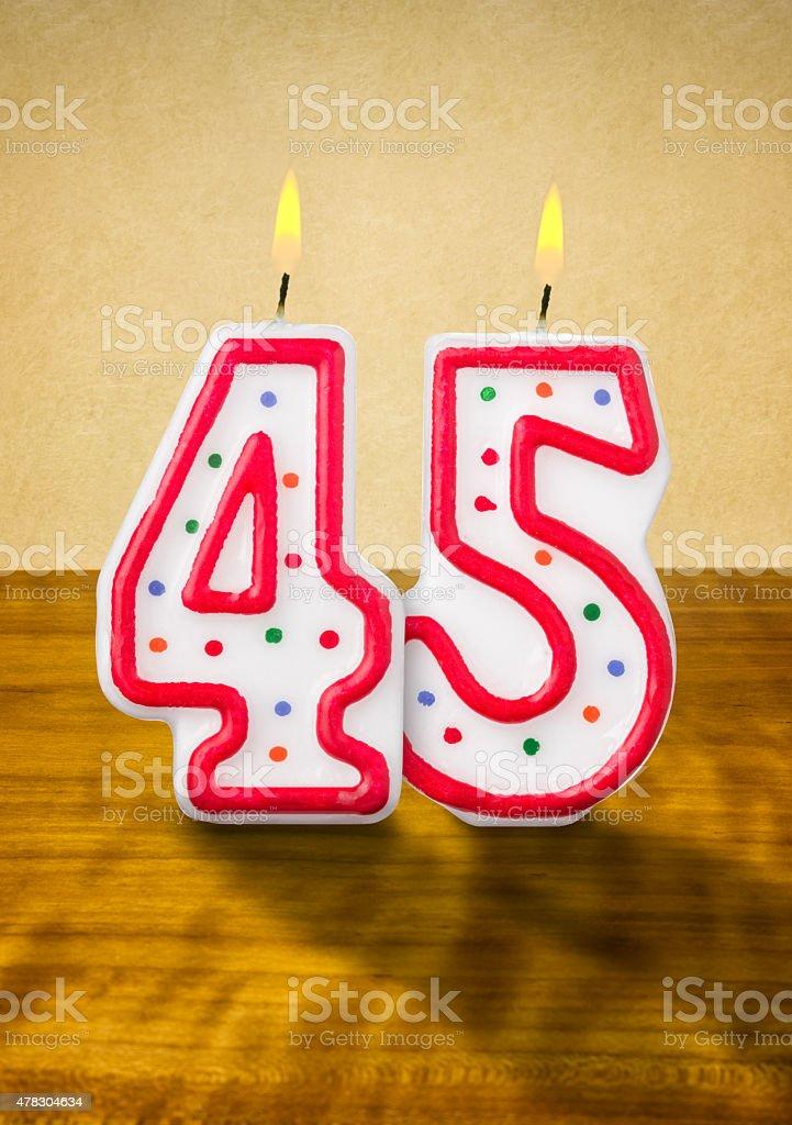 Burning birthday candles number 45 stock photo