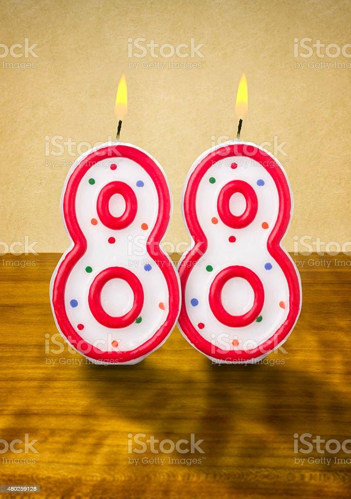 Burning 誕生日のロウソク番号 88 ストックフォト