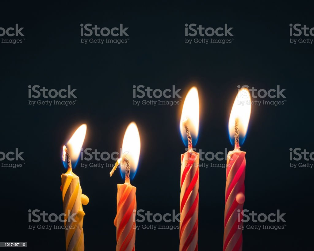 Burning Birthday Candles On Dark Background With Fire