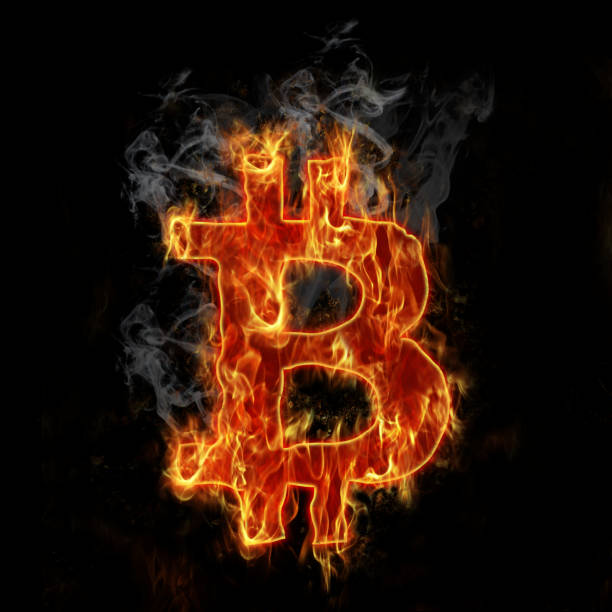 Burning bitcoin symbol stock photo
