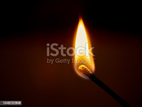 istock burning blaze on a dark background 1048232806