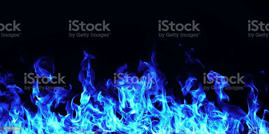 burning blue  fire flame on black background stock photo