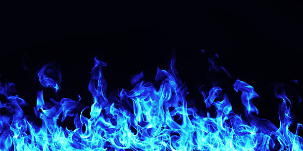burning blue  fire flame on black background - vlam stockfoto's en -beelden