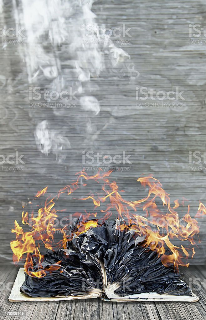 Burning book stock photo
