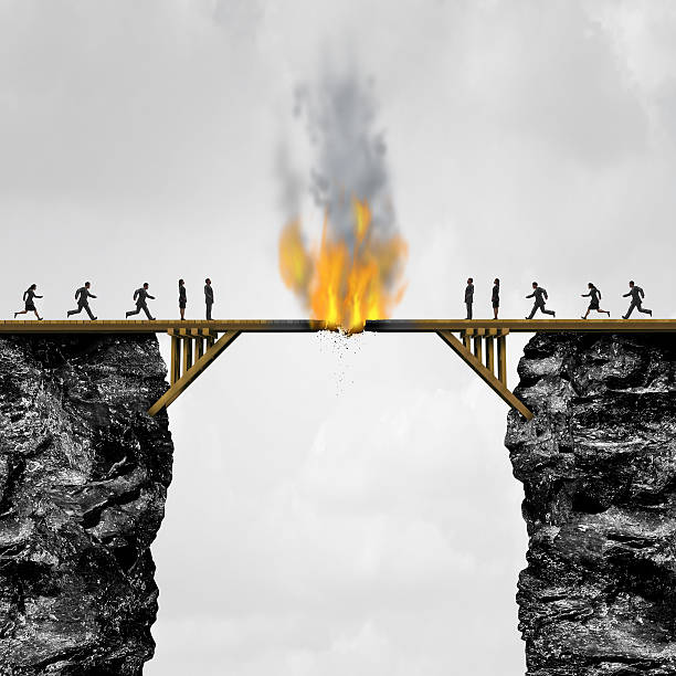 Burning Bridges Concept Burning bridge concept as groups of people divided by a wooden bridge on fire as a business connection risk metaphor for destroying a link or isolationism with 3D illustration elements. detach stock pictures, royalty-free photos & images
