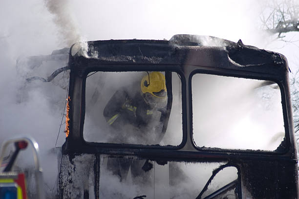 burning bus on fire stock photo