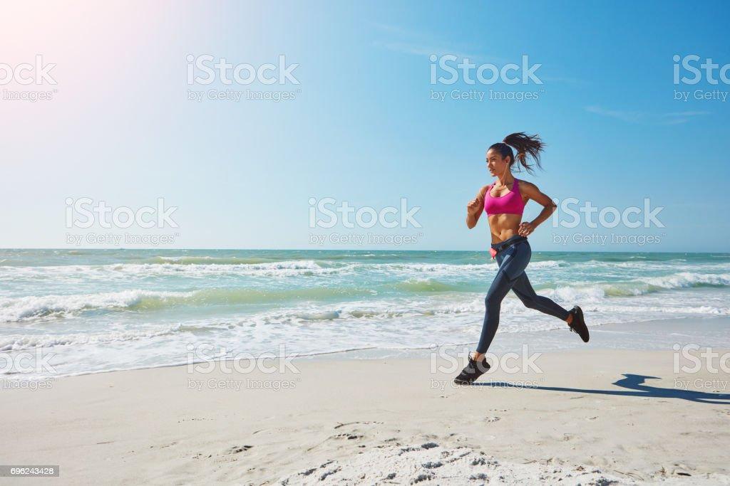 Burning calories at the beach stock photo