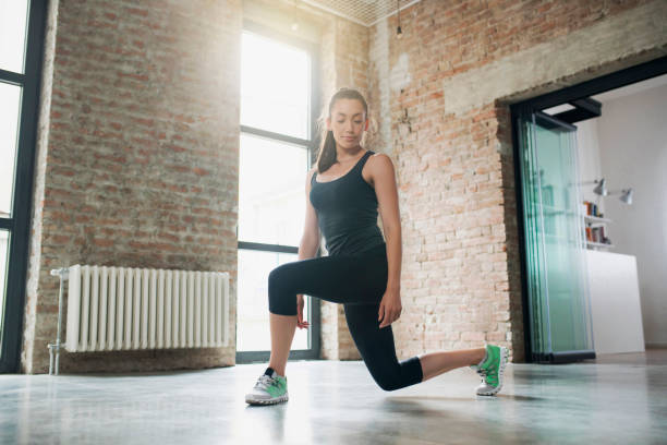 burning calories - lunge stock photos and pictures