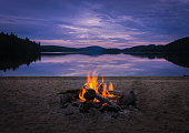 istock Burning campfire on the beach on my kayak camping trip 1257681377
