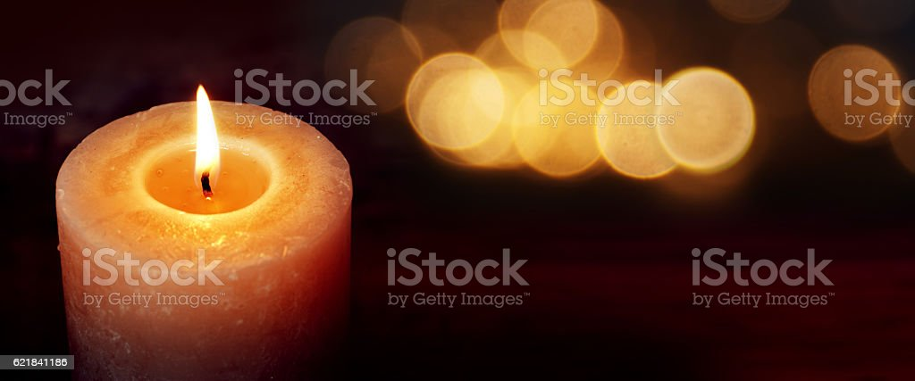 Burning candle for silence moments stock photo