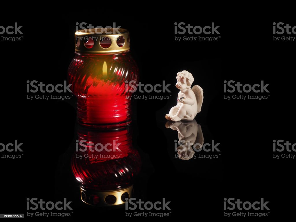 Burning candle in a red glass candlestick foto stock royalty-free